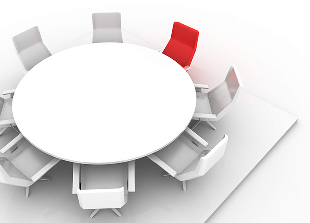 round able with white chairs and one red chair